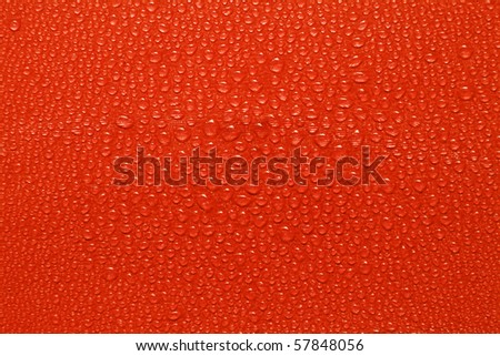 Water drops on red paper - stock photo