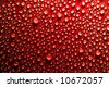 water drops on red surface - stock photo