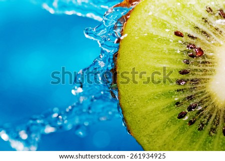 water drops on slice of kiwi - stock photo