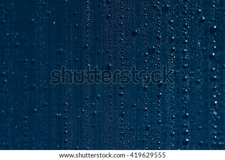 Water drops on the background. Condensate. Indigo background. Water drops background. - stock photo
