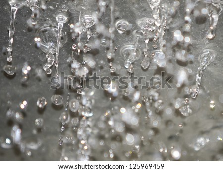 Water drops on the embossed surface - stock photo