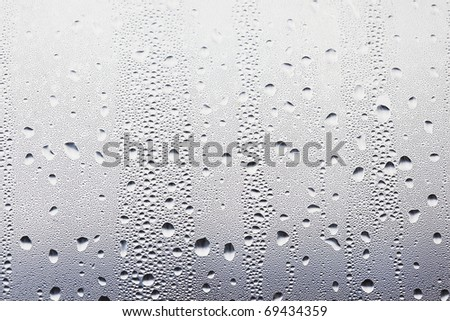 water drops on the glass background image - stock photo