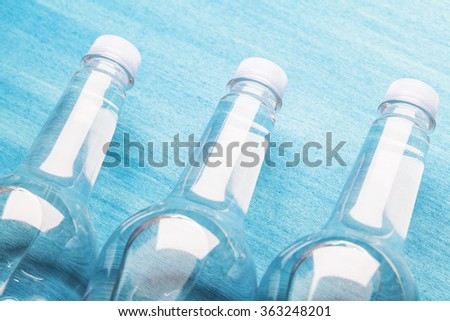 water drops on the surface of a plastic bottle - stock photo