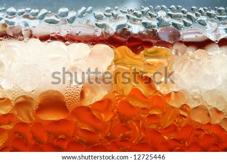 Water drops on the surface of glass with icy cold drink