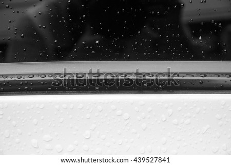 water drops on the surface of the white car - Black and White - stock photo