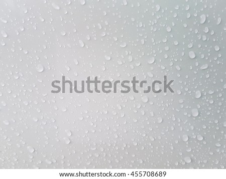 Water drops on the white surface for background
