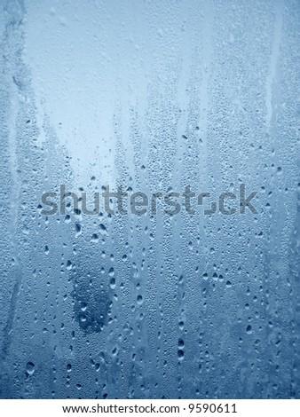 Water drops on wet window - stock photo
