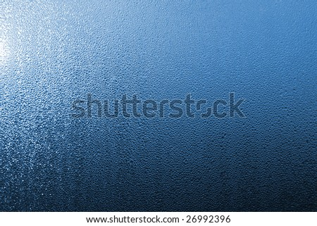 water drops on window blue glass - stock photo