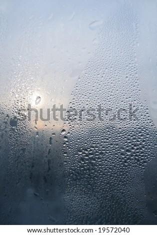 Water drops on window glass - stock photo