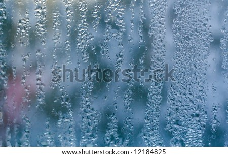 Water drops on window glass, blurred background beside glass, cold weather