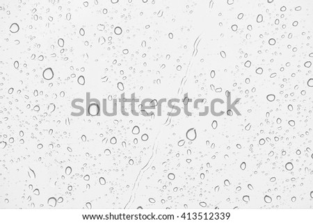 water drops on windows in raining day, black and white mode. - stock photo