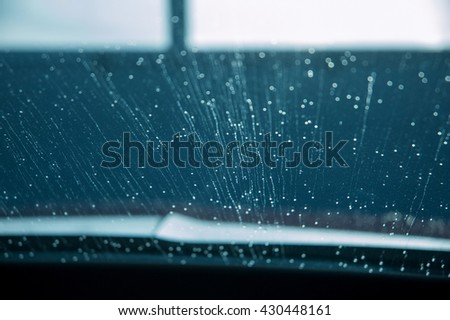 Water drops on windshield at car wash - stock photo