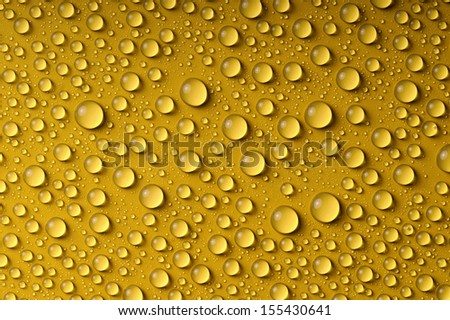 water drops on yellow surface - stock photo