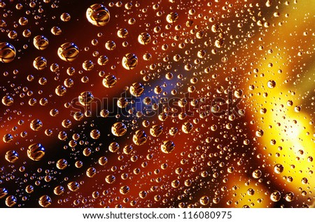 Water drops over colored background - stock photo