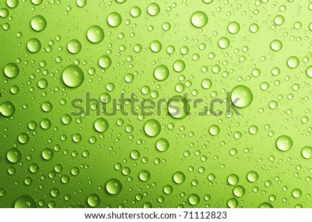 Water drops over green.Closeup - stock photo