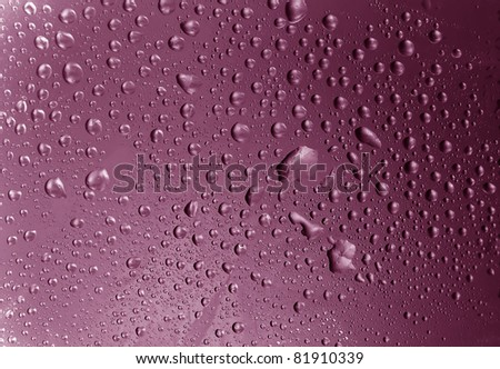 water drops purple tones - stock photo