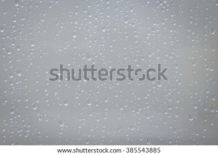 water drops rain on mirror - stock photo