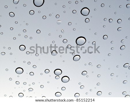 Water Drops with Sky Reflections - stock photo