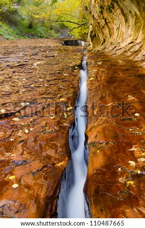Water eroded slot in navajo sandstone creek bed - stock photo