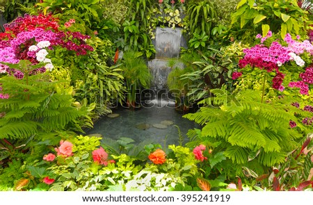 Water Fall and Flower beds in the Spring with Lush colors, Victoria, Canada  - stock photo