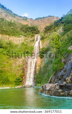 Water fall in middle in seoul city - stock photo