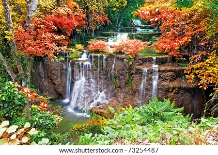 Water fall in spring season located in deep rain forest jungle - stock photo