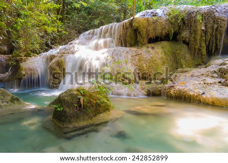Water fall in spring season located in deep rain forest jungle, Thailand - stock photo