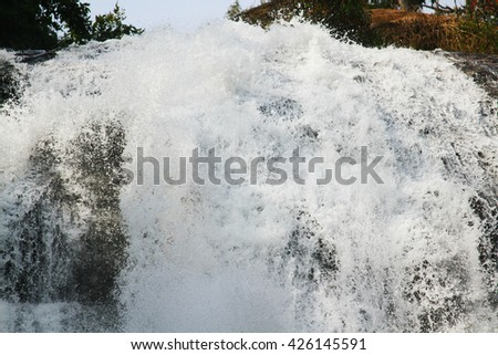 Water fall in spring season located in deep rain forest jungle,Thailand - stock photo