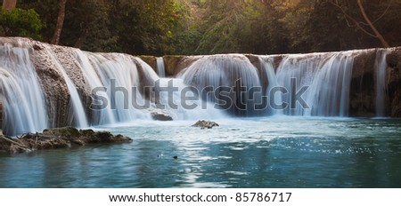 Water fall in spring season located in Thailand. - stock photo