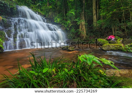 water fall scene in green nature and stone - stock photo