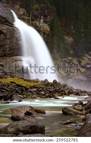 Water falling down to rocks - stock photo