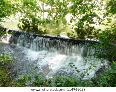 Water falling over a weir - stock photo