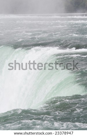 Water falling over the edge of the Niagara Falls in close up - stock photo