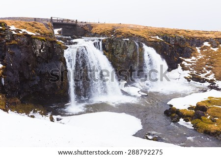 Water falls in deep Iceland national park on the raining day - stock photo