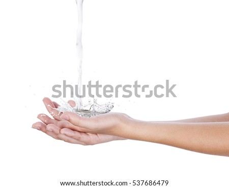Water falls on the palm of the hands, splashing in all directions, on a white background