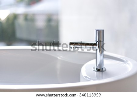 Water faucet with bath tube - stock photo
