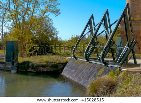 Water filtering system for electric turbine station - stock photo