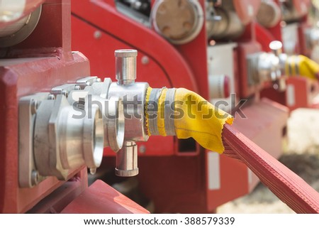 water fire hose with truck  - stock photo