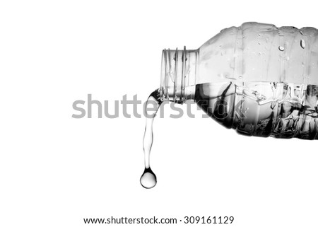Water flow from a bottle - stock photo