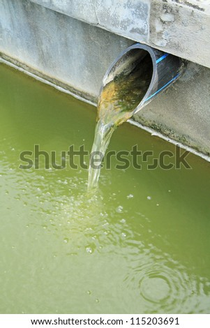Water flow from water pipe - stock photo