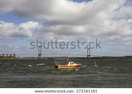 Water flow in Little Belt close to The Little Belt Bridge in Denmark. - stock photo