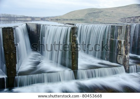 Water flowing from dam. lake. - stock photo