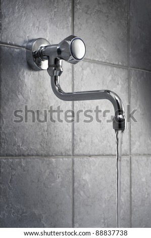 Water flowing from the faucet - stock photo