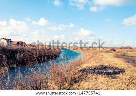 Water flowing in an irrigation canal in Belgrade - stock photo