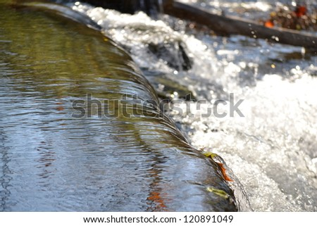 Water Flowing into a Water Storage Reservoir at a Water Treatment Facility - stock photo