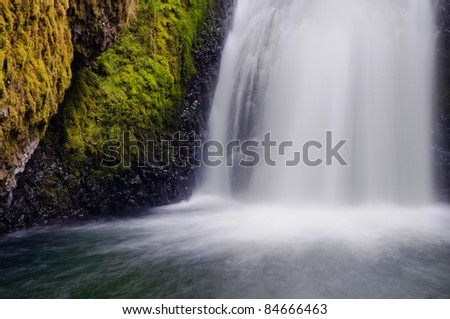 Water flowing into pool at the bottom of Bridal Veil Falls - stock photo
