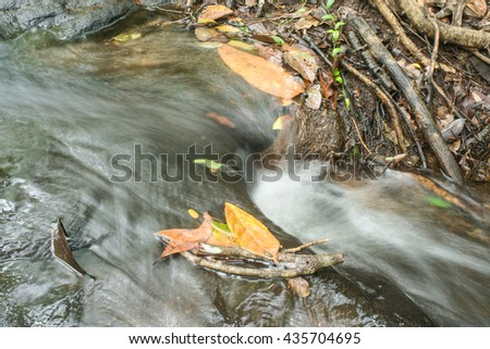 Water flowing over rocks. - stock photo