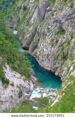 Water flowing rapidly across rocks at the bottom of a canyon, Montenegro - stock photo