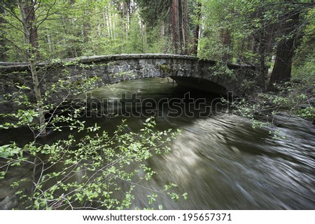 Water flowing under the stone bridge, Yosemite national park, USA - stock photo