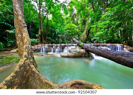 Water flows along a mountain stream - stock photo